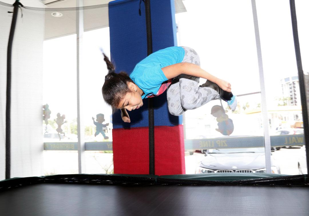 girl doing flips on trampoline