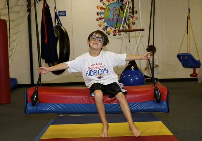 kid on bolster swing