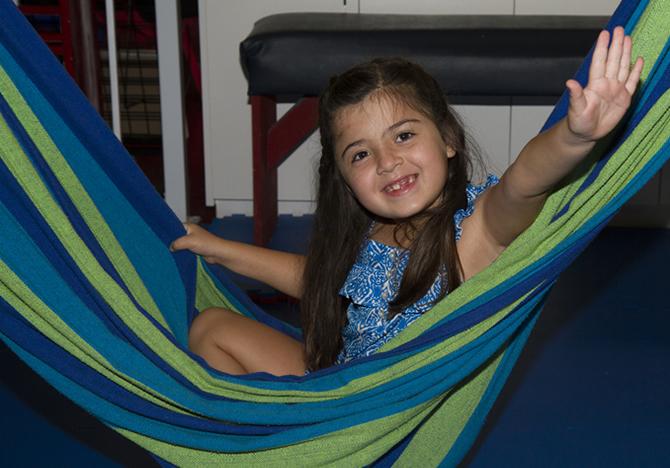 girl smiling in hammock swing