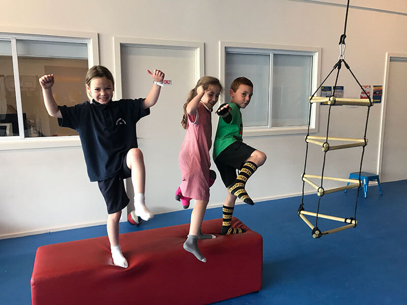 kids posing on foam block