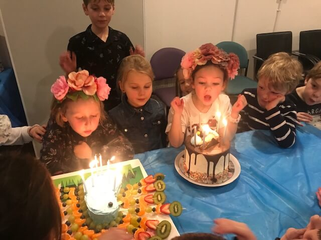 kid blowing out candles